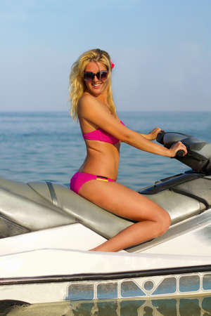 jetski: Cute smiling young woman on a jet ski
