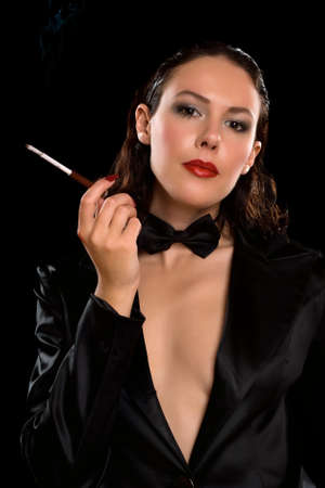 Portrait of a elegant young brunette with cigarette photo