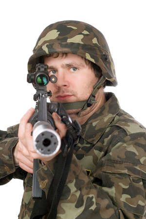 Armed soldier aiming m16 in studio. Isolated photo