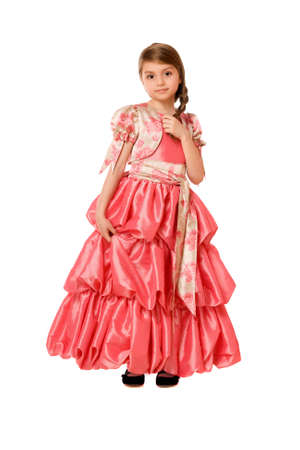 Charming little girl in a long dress. Isolated Stock Photo