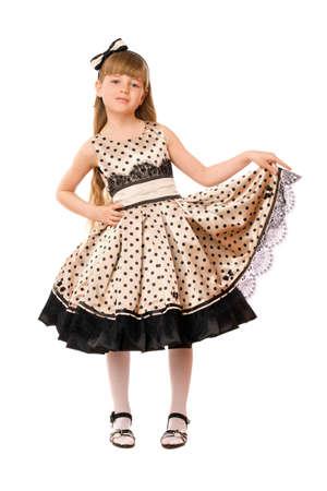 little black dress: Pretty little girl in a dress. Isolated