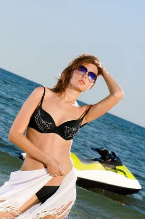 jetski: Pretty young woman in a black bikini
