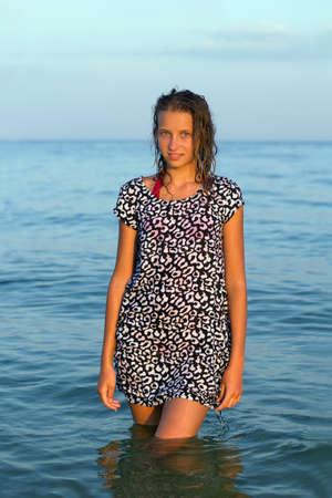 Portrait of a cute teen girl in wet dress Stock Photo - 15688074