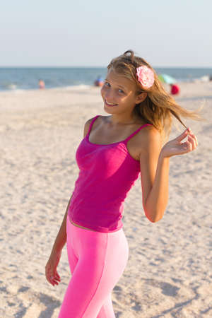 singlet: Portrait of a cheerful teen girl on the beach