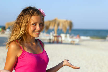 Closeup portrait of a happy teen girl on the beach photo