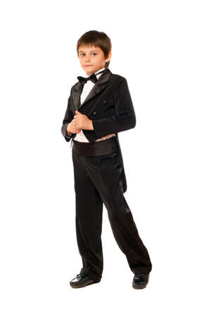 Little boy in a tuxedo. Isolated on white photo