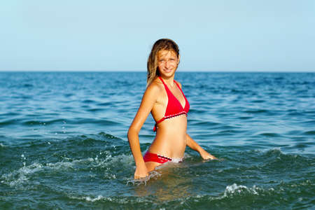 Smiling teen girl having fun in the sea Stock Photo - 15751647