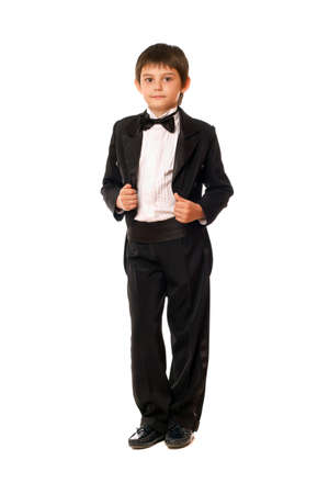 Handsome little boy in a tuxedo. Isolated on white photo