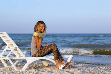 Joyful nice teenage girl on a lounge chair Stock Photo