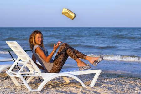 leggings: Joyful cute teenage girl on a lounge chair Stock Photo