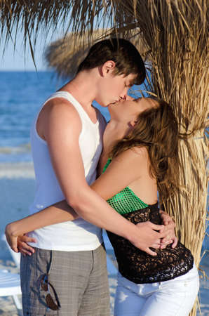 Portrait of a kissing young couple on the beach Stock Photo - 16682505