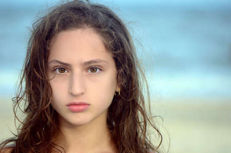 Portrait of a serious teen girl on the beach Stock Photo