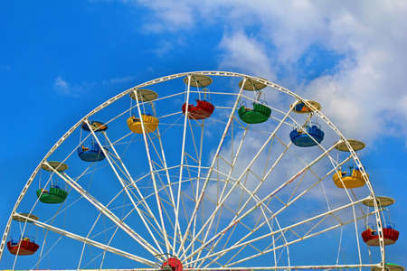 Ferris wheel on a background of blue sky photo