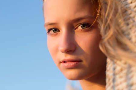 Closeup portrait of a beautiful teen girl outdoors photo
