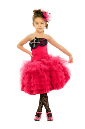 Nice little girl in a pink dress photo