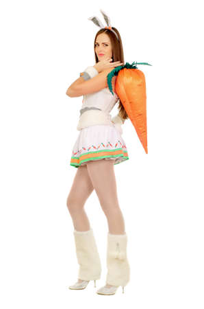 Pretty young woman with a carrot. Isolated  photo