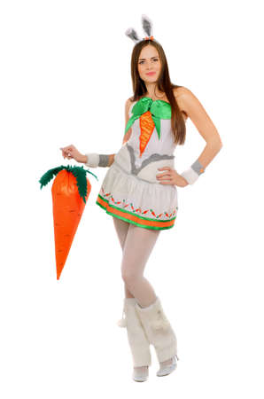 Nice young woman with a carrot. Isolated photo