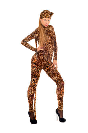 Pretty young woman dressed as a leopard. Isolated
