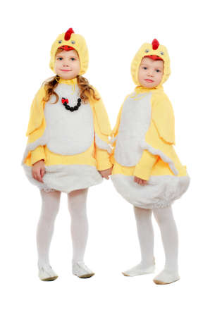 Two small children dressed as chickens. Isolated