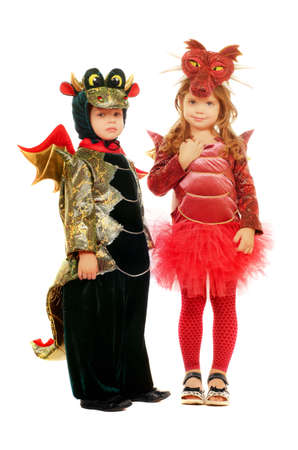 Two small children dressed as dragons. Isolated Stock Photo
