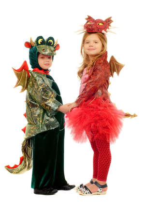 Two small children dressed as dragons. Isolated on white photo