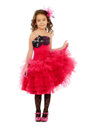 Beautiful little girl in a pink dress