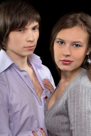 Closeup portrait of a young loving couple. Isolated photo