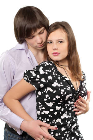 Portrait of a happy young loving couple. Isolated photo
