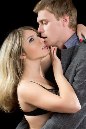 Closeup portrait of a young passionate couple. Isolated photo