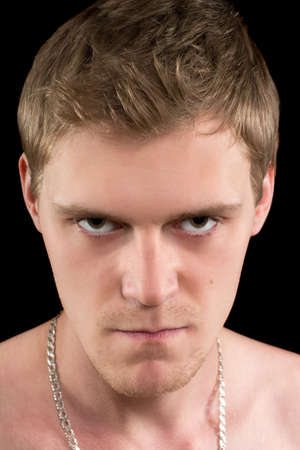 expression facial: Closeup portrait of a angry young man. Isolated