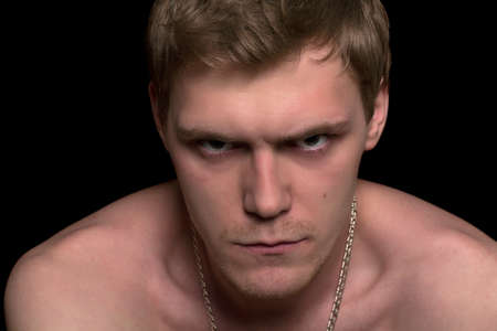 Closeup portrait of a angry young man. Isolated on black Stock Photo - 17538977