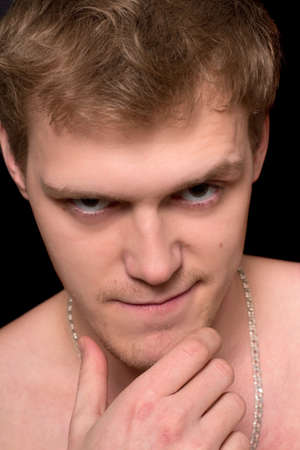 spiteful: Closeup portrait of a spiteful young man. Isolated