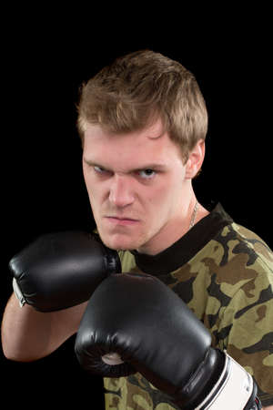 Angry young man in boxing gloves. Isolated Stock Photo - 17526953
