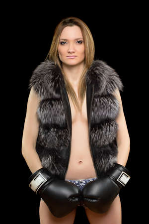 Portrait of a young blonde in boxing gloves Stock Photo - 17538898