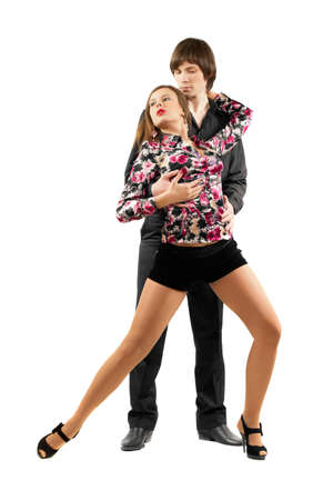 Young sensual couple dancing tango. Isolated on white photo