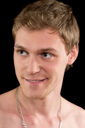 Closeup portrait of a smiling funny young man. Isolated Stock Photo - 17640281