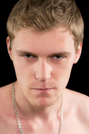 Closeup portrait of a suspicious young man. Isolated Stock Photo - 17640303