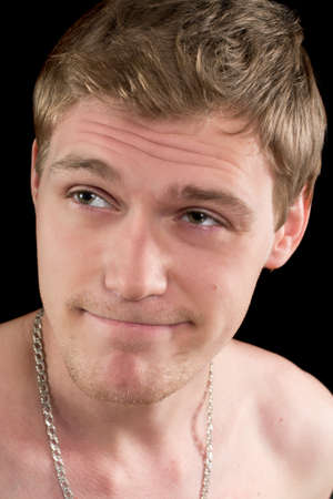 Closeup portrait of a pensive funny young man. Isolated Stock Photo - 17658161