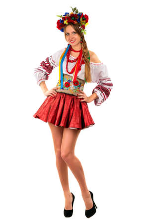 Smiling young woman in the Ukrainian national clothes. Isolated photo