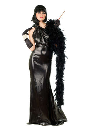 black boa: Brunette with a cigarette holder dressed in retro style. Isolated