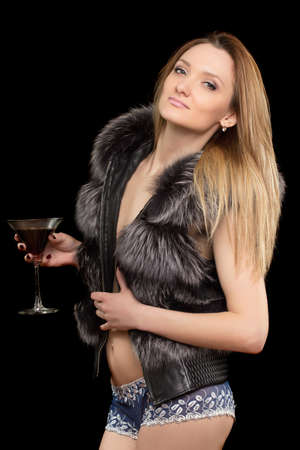 Portrait of pretty young blonde with a glass in hands. Isolated photo