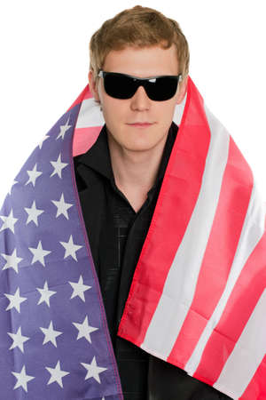 Young man in the American flag. Isolated photo