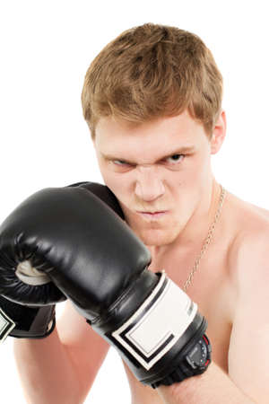 Angry young man in boxing gloves. Isolated Stock Photo - 17850136