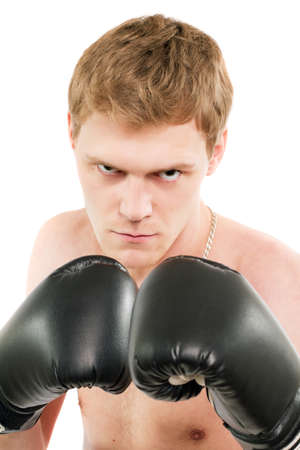 Angry young man in boxing gloves. Isolated on white Stock Photo - 17850174