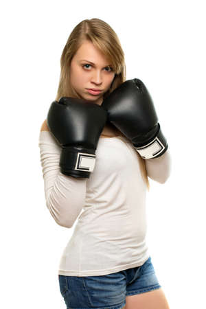 Young seus woman in white blouse posing with boxing gloves. Isolated  Stock Photo - 18201779