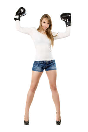 leggy girl: Attractive leggy young lady posing in  black boxing gloves. Isolated Stock Photo