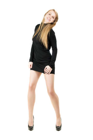 nice legs: Young smiling blond woman in short black dress showing her nice legs. Isolated on white