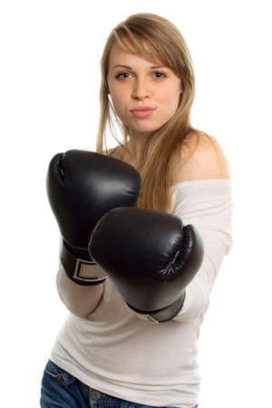 Charming young woman in white blouse with black boxing gloves. Isolated photo