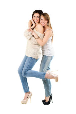 Two smiling caucasian women dressed in casual clothing. Isolated on white photo