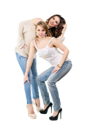 Sexy blonde and brunette posing in casual clothing. Isolated on white photo
